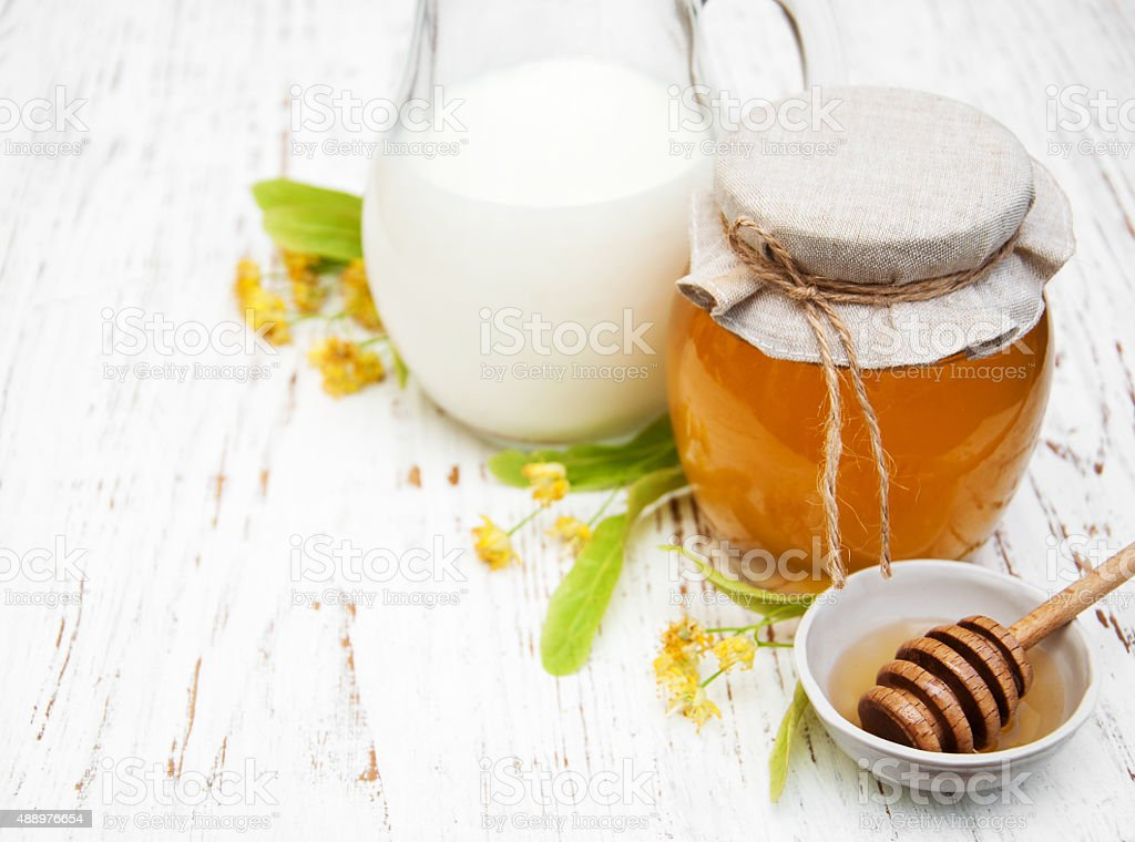 Linden honey and milk stock photo