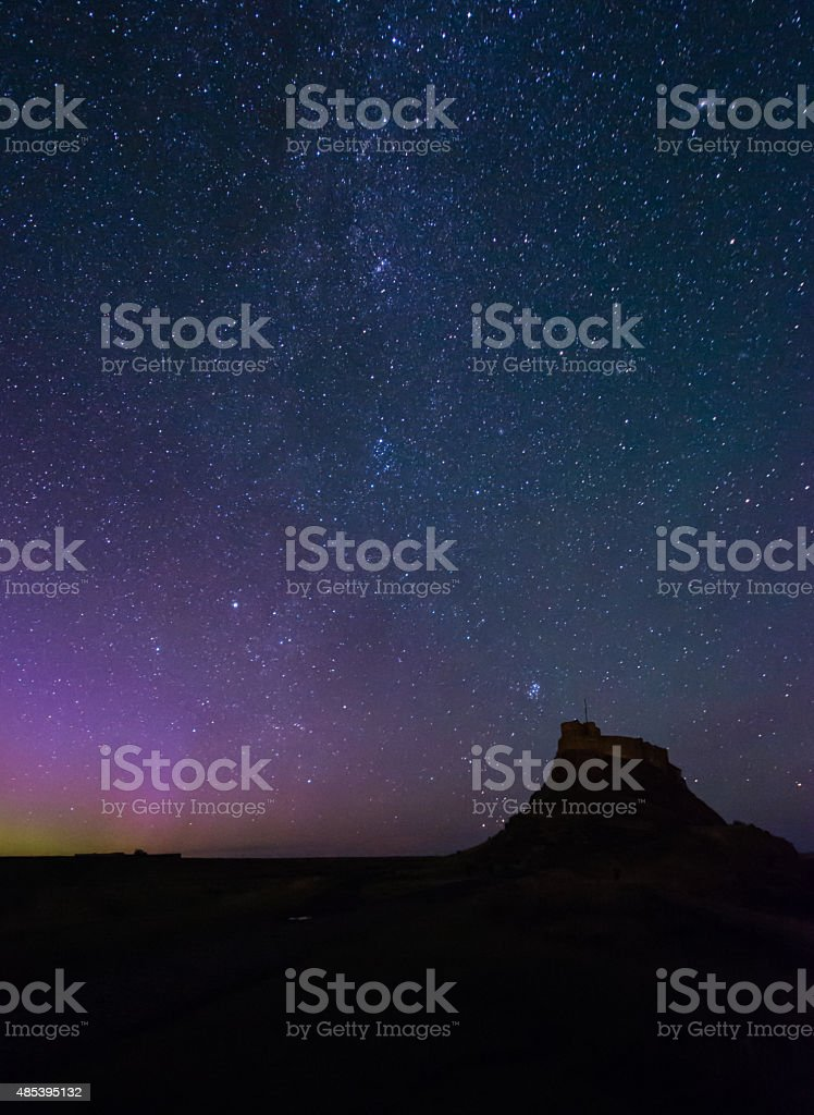 Lindisfarne Castle and Northern Lights stock photo