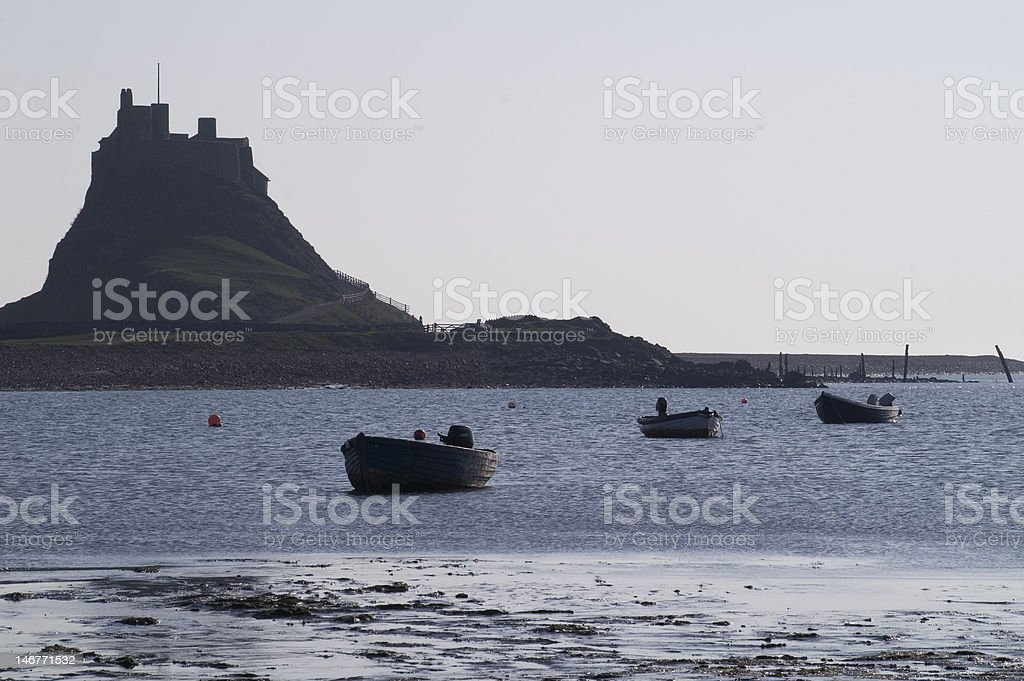 Lindisfarne Castle from the Harbour stock photo