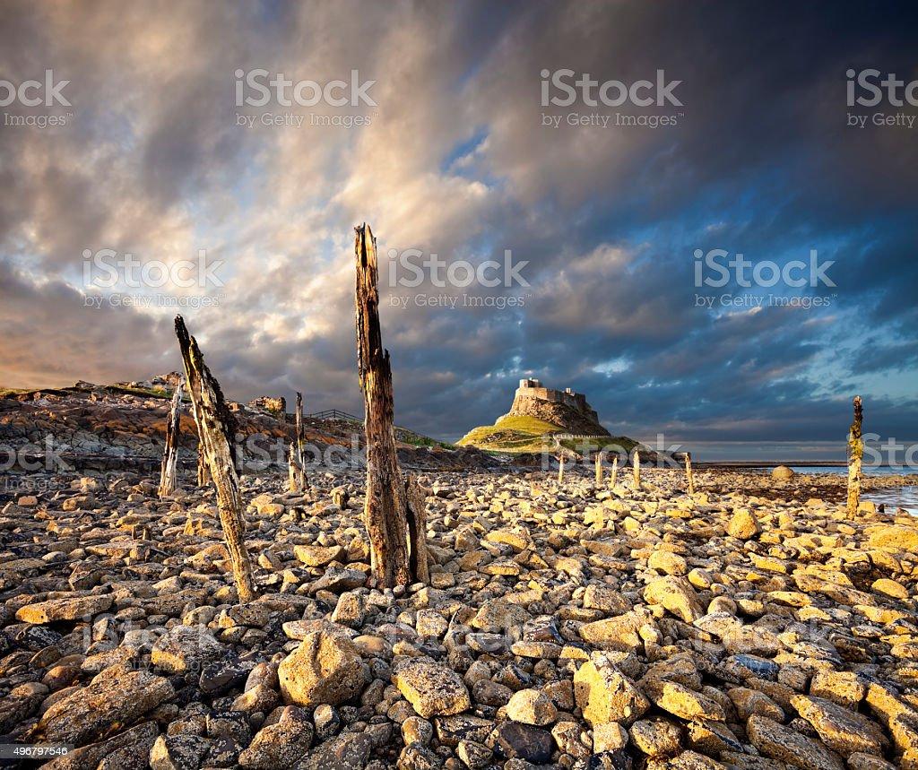 Lindisfarne Castle, Northumberland, England at sunset stock photo