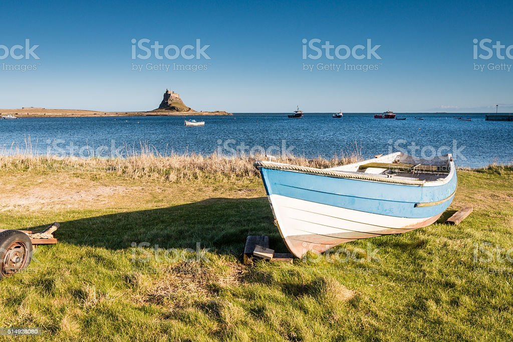 Lindisfarne Harbour and Castle stock photo