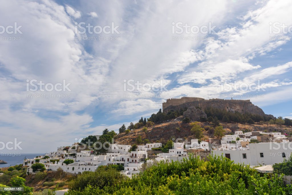 Lindos town with fort on the hill, Rhodes stock photo