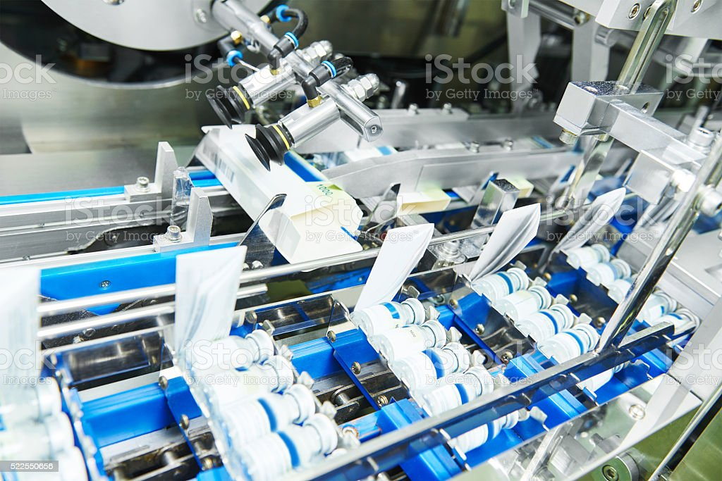 Line conveyer for packaging ampoules in boxes stock photo