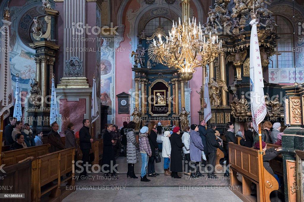 Line for communion at St. Andrew's church in Lviv, Ukraine stock photo