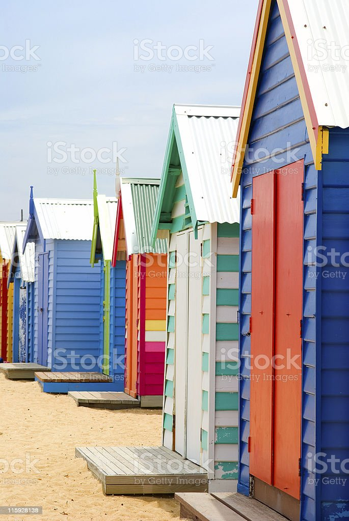 Line of Brightly Coloured Beach Boxes on Brighton Beach Melbourne stock photo