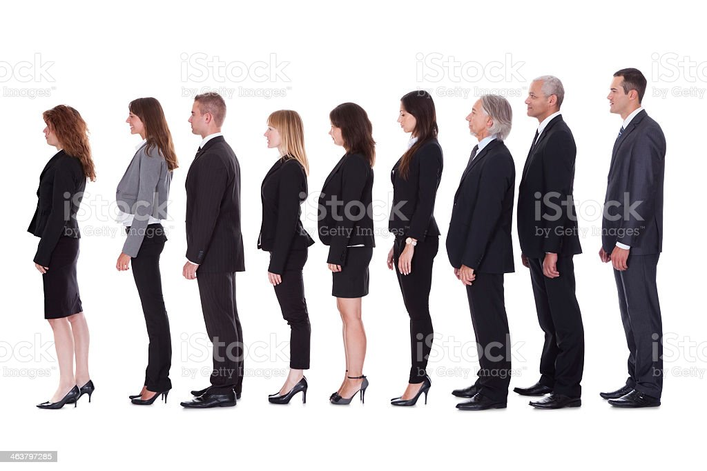 A line of businessmen and women in profile on white stock photo