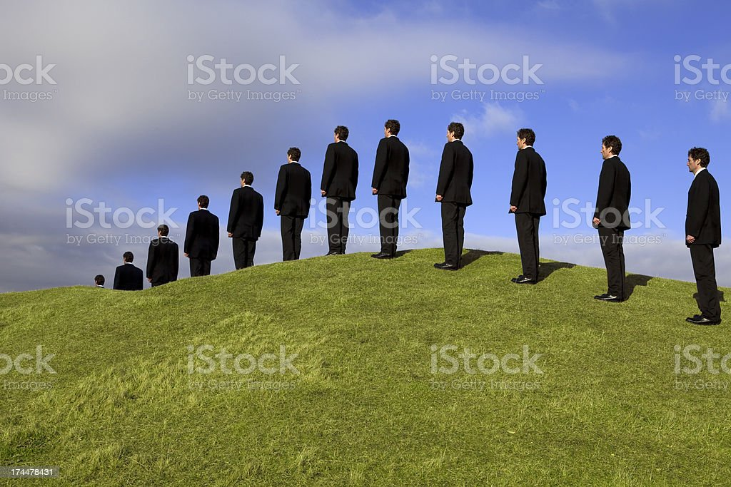 Line of Businessmen In An Orderly Queue royalty-free stock photo