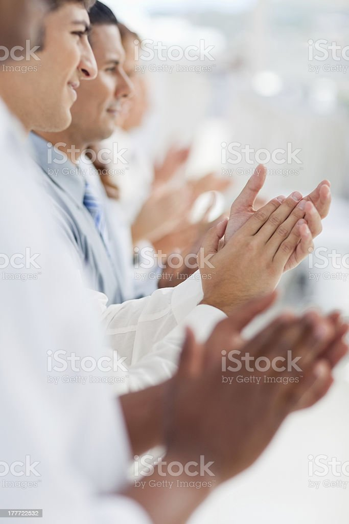 Line of businesspeople clapping royalty-free stock photo