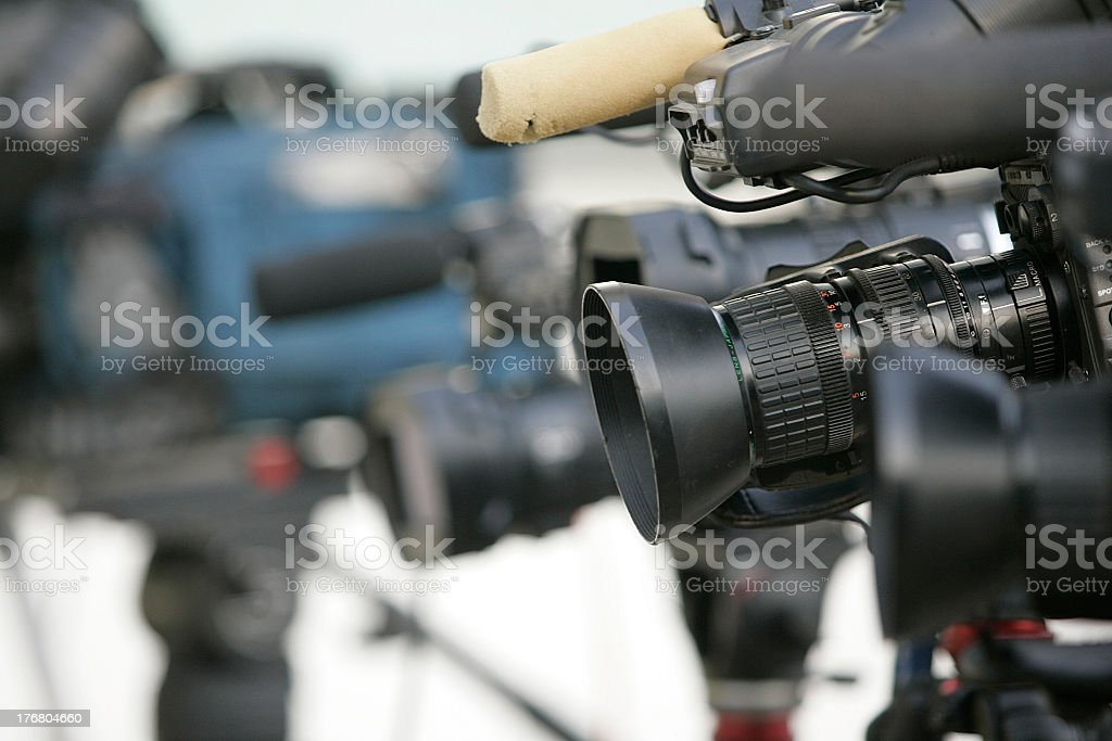 Line of cameras waiting for news stock photo