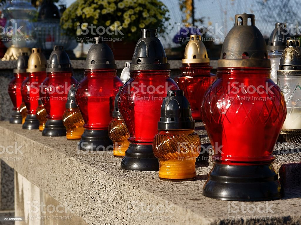 line of candles on tomb during All Souls' Day stock photo