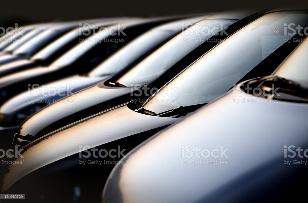 Line of cars at sunset stock photo