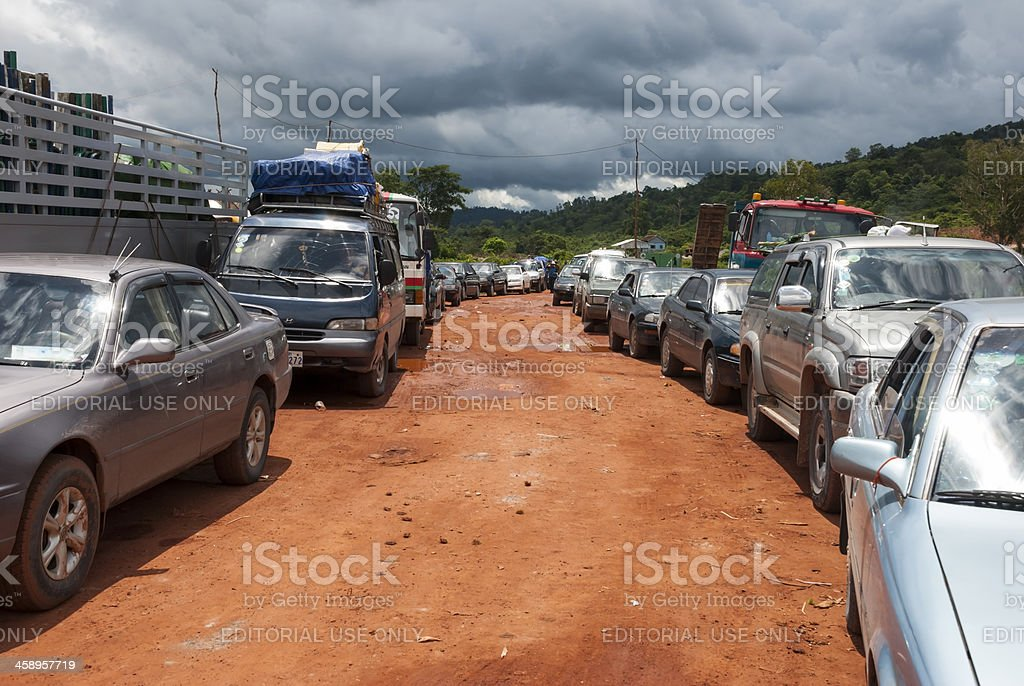 Line of cars in rural Cambodia royalty-free stock photo
