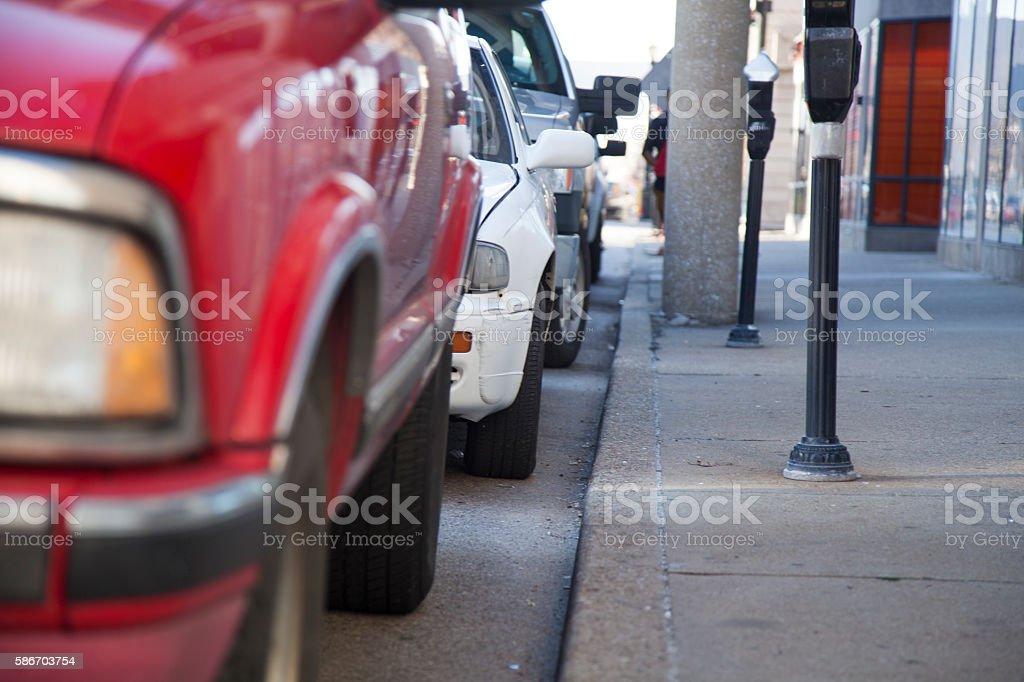 Line of cars on sidewalk stock photo