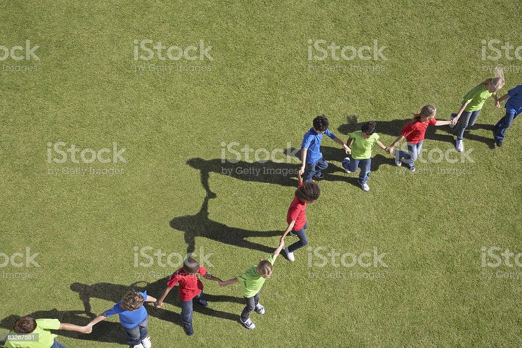 Line of children holding hands royalty-free stock photo