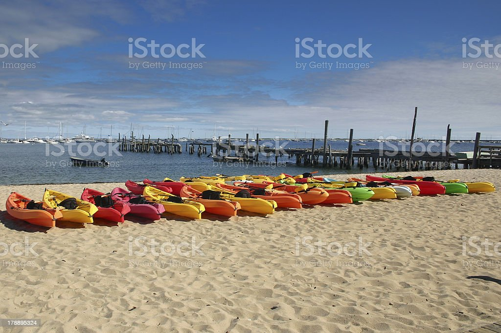 Line of colorful Kayaks royalty-free stock photo
