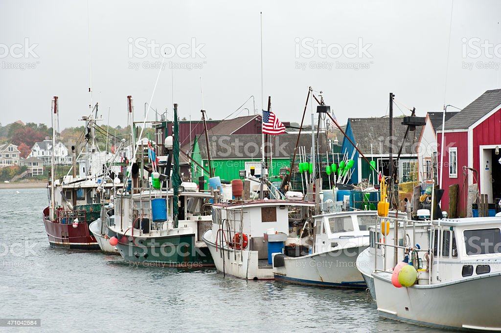 Line of colorful lobster boats, Portland, Maine. stock photo