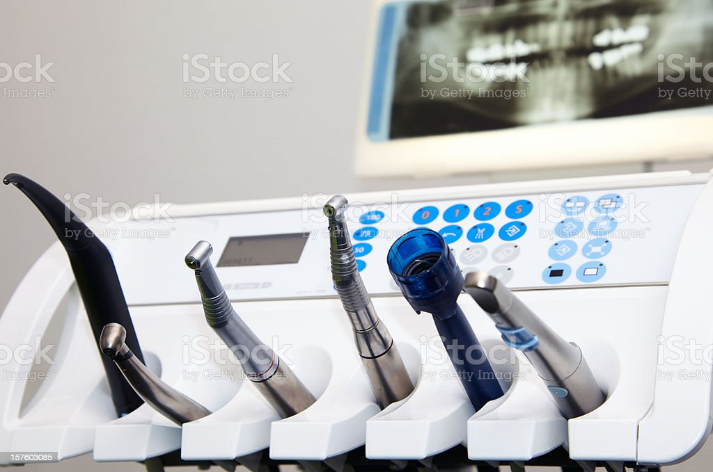 A line of dental equipment on a stand stock photo