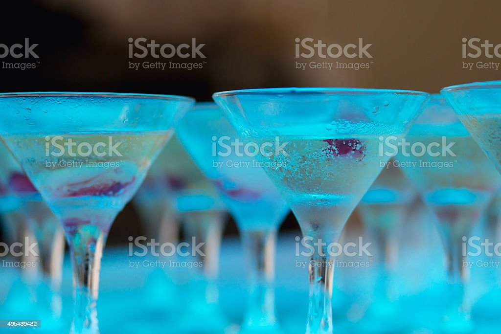 Line of different alcohol cocktails on event open-air night party stock photo