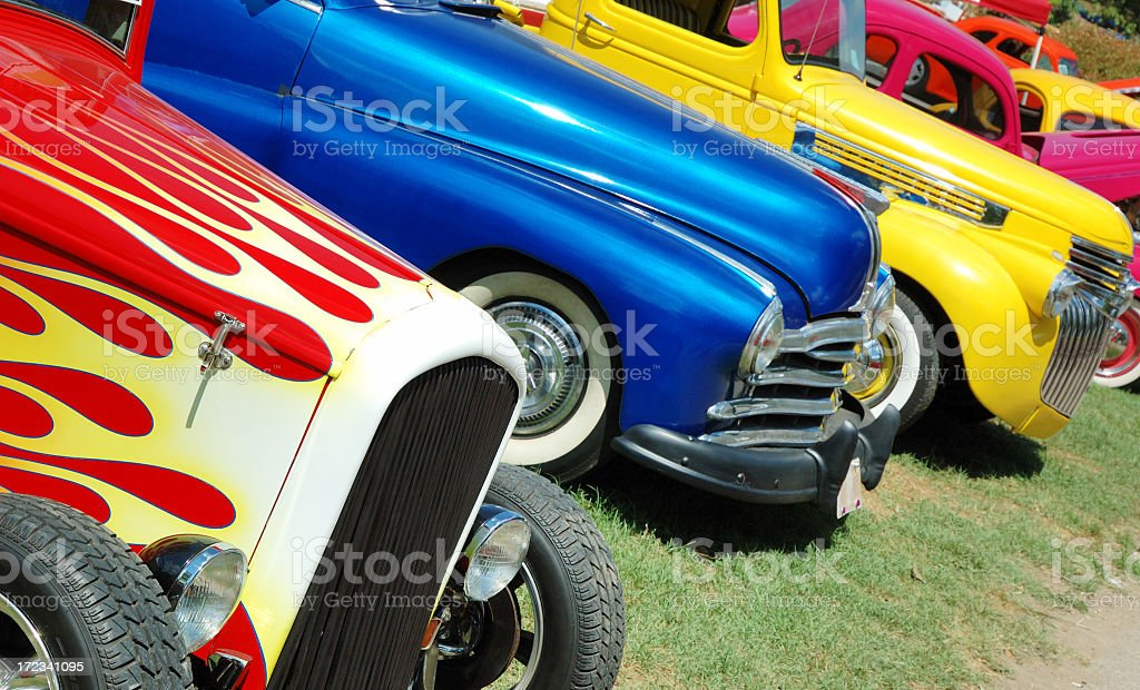 Line of hotrod cars in grass at car show stock photo