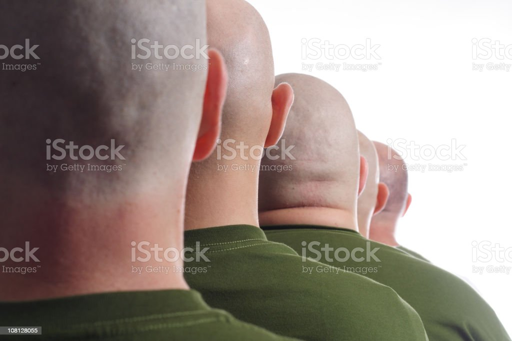Line of Male Soldiers with Shaved Heads stock photo