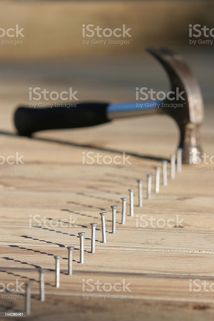 Line of nails and hammer stock photo