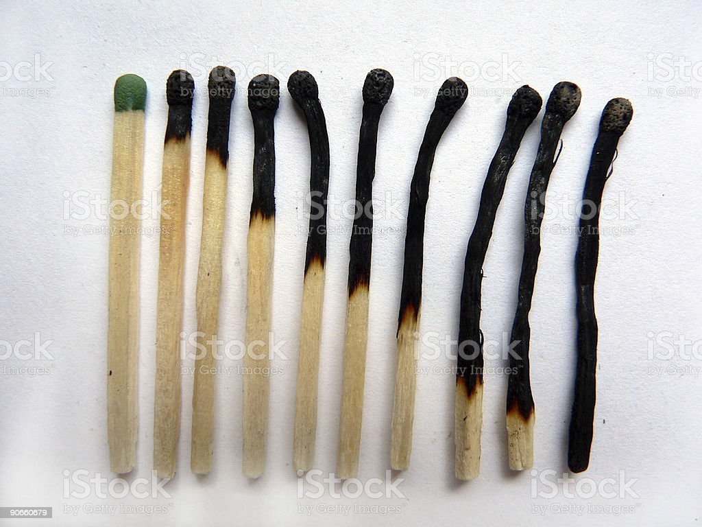 Line of new and burnt matches royalty-free stock photo