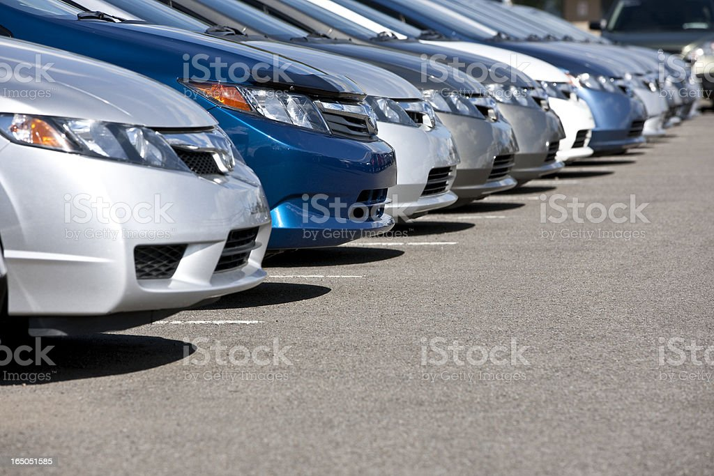 Line of new compact cars at dealership. stock photo