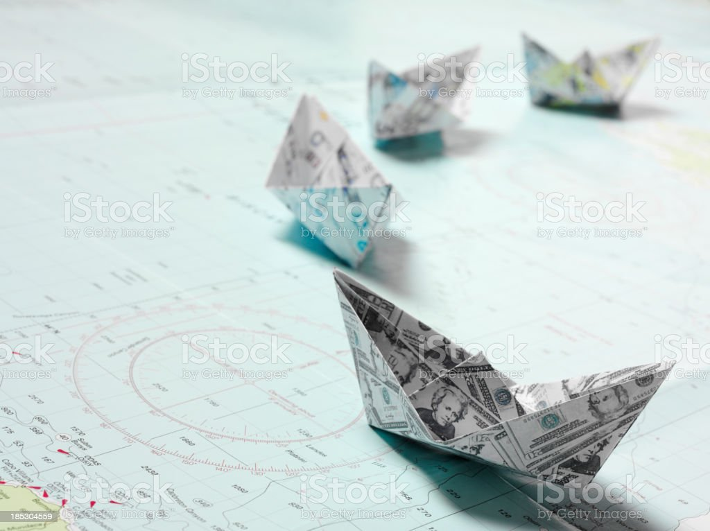 Line of Origami Boats in Currency stock photo