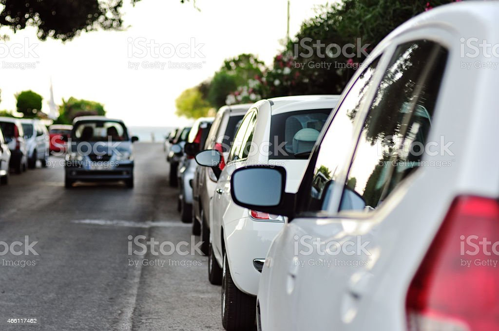 line of parked cars stock photo