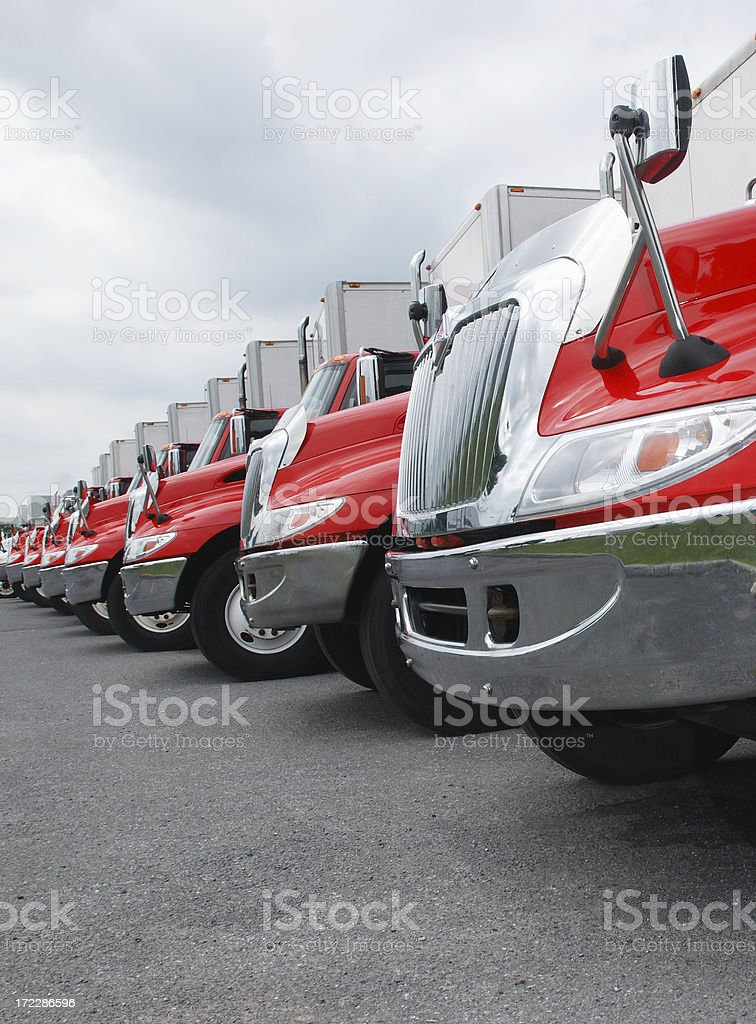 Line of parked red and shiny trucks stock photo