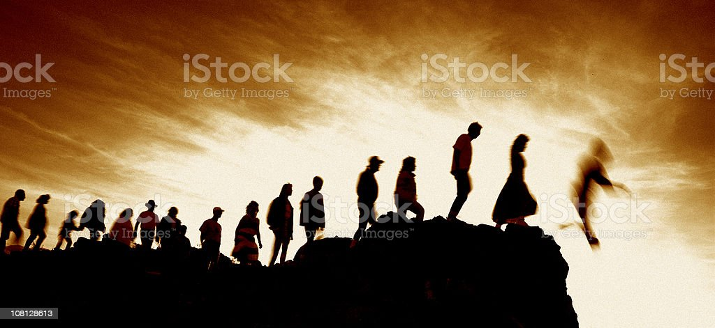 Line of People Walking Single File Off Cliff stock photo