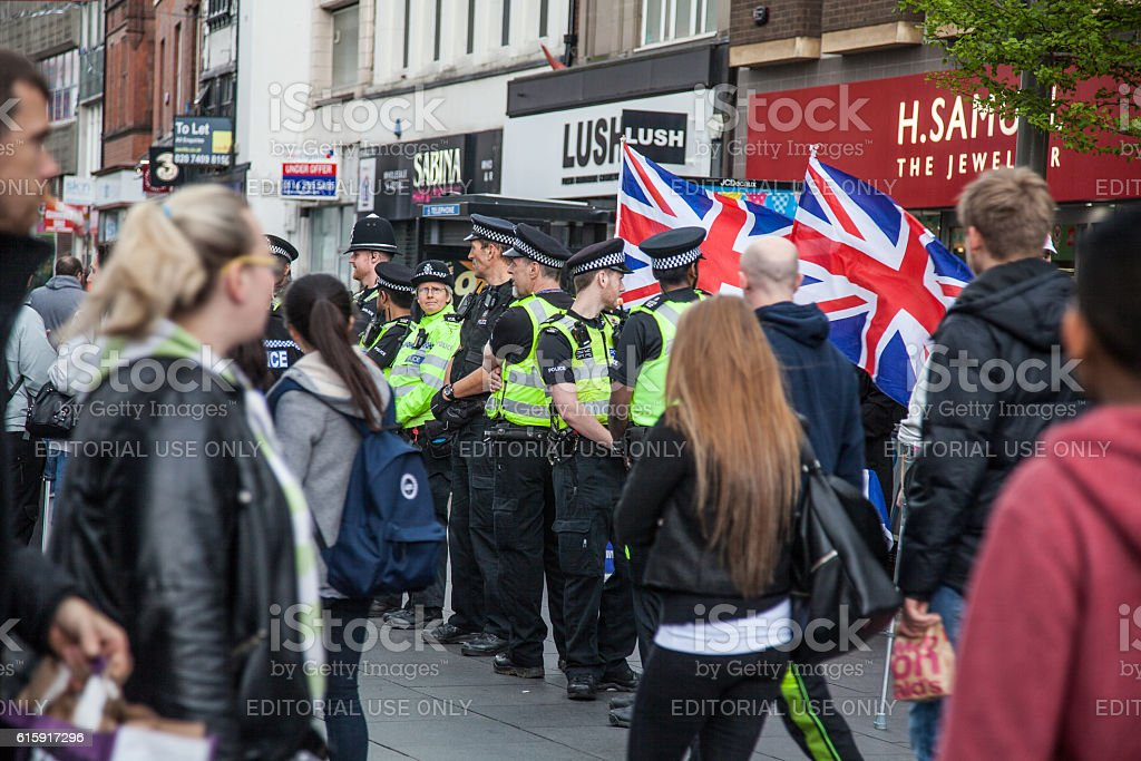 line of police officers at demonstration stock photo