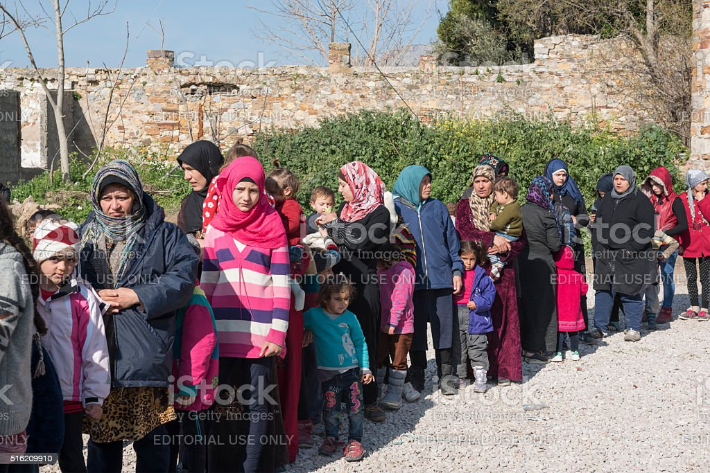 Line of refugees at Chios waiting for food stock photo