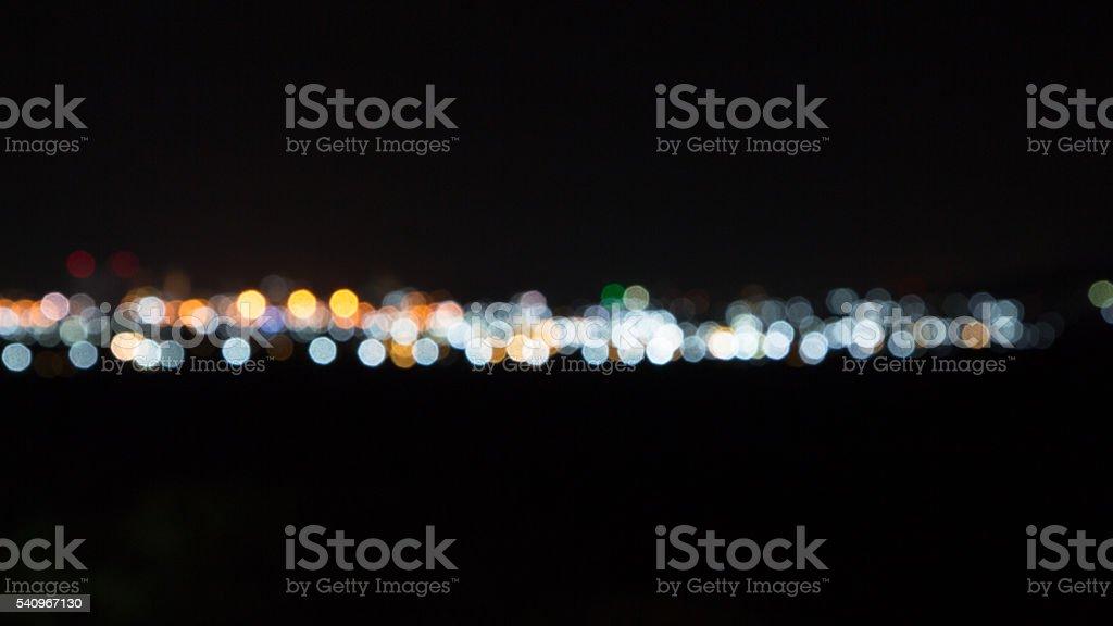 line of round and circle bokeh in dark night background Стоковые фото Стоковая фотография