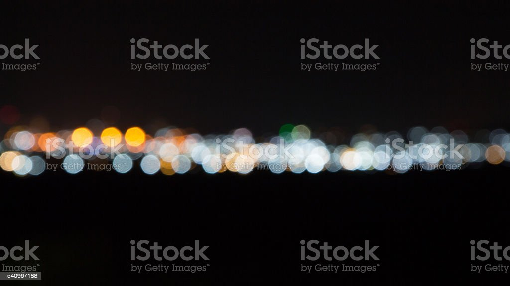 line of round and circle bokeh in dark night background Стоковые фото Стоковая фотография