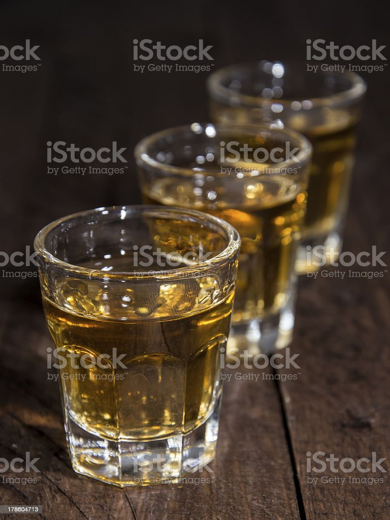 Line of Rum Shots on wooden background royalty-free stock photo