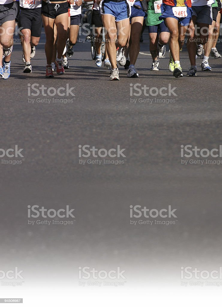 Line of runners on professional city marathon stock photo