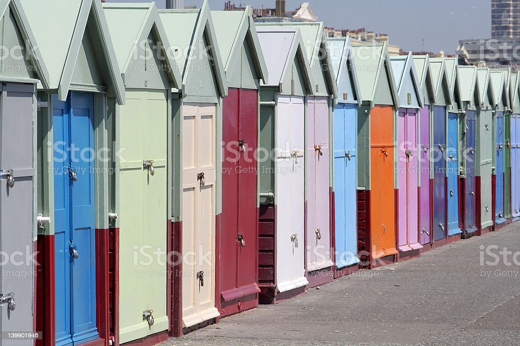 Line of seaside huts on Brighton seafront stock photo