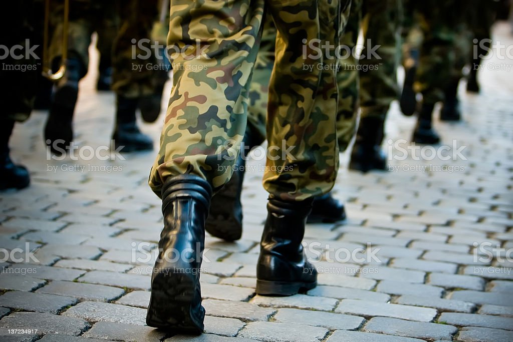 Line of soldiers in uniform, marching in formation stock photo