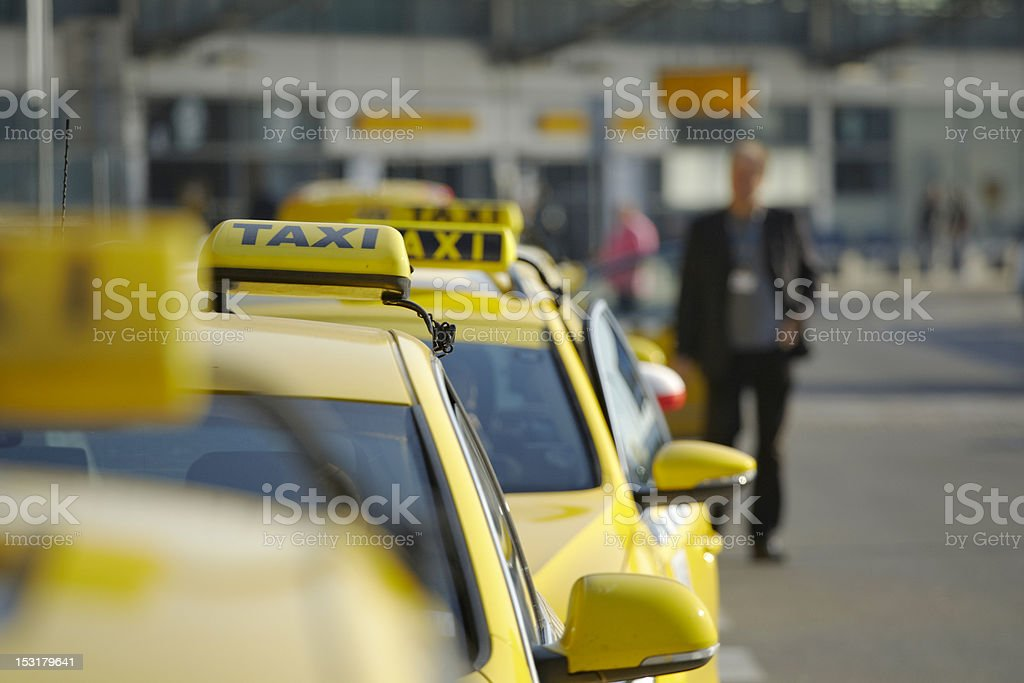 A line of taxis and an out of focus man stock photo