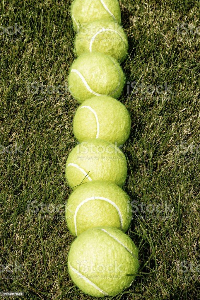 Line of tennis balls stock photo