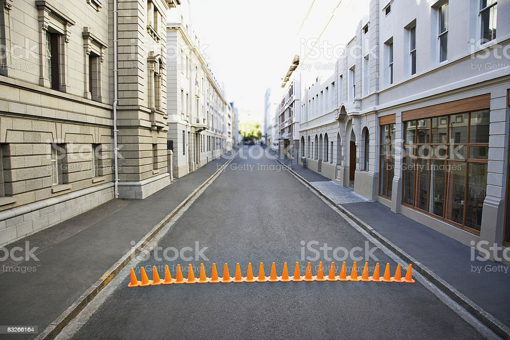 Line of traffic cones in urban roadway royalty-free stock photo