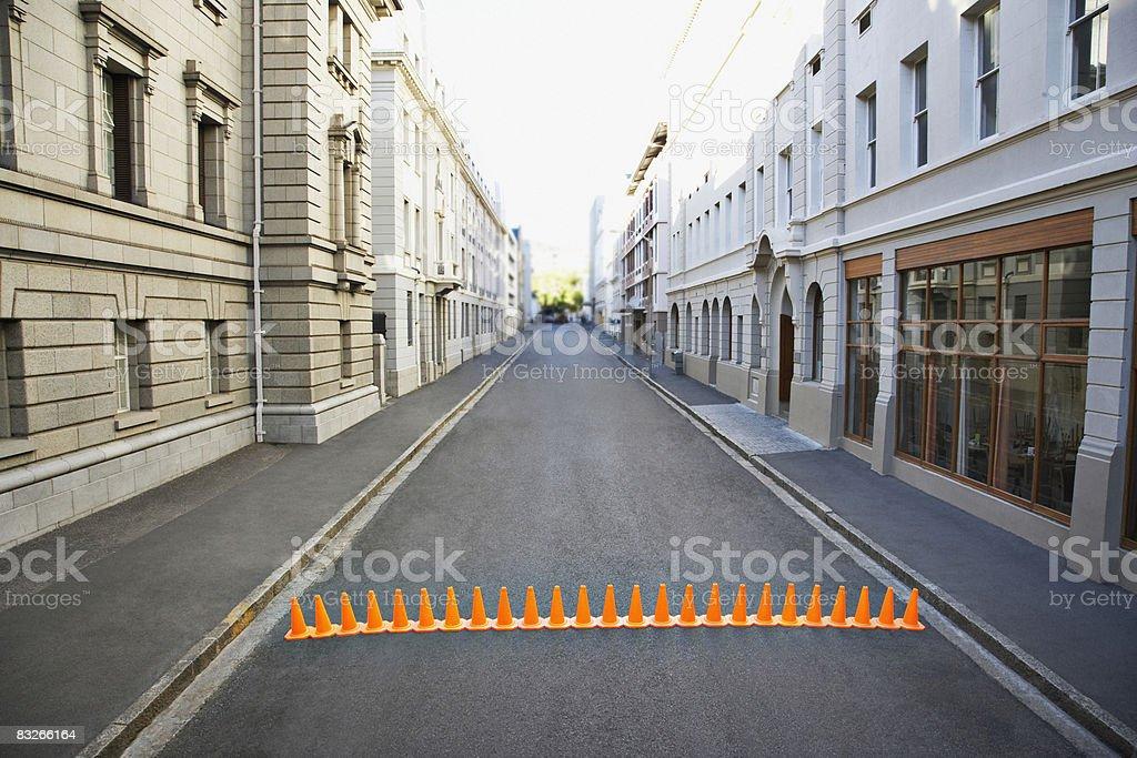 Line of traffic cones in urban roadway stock photo
