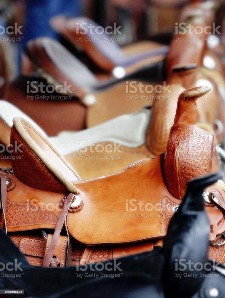 Line of Western Saddles stock photo