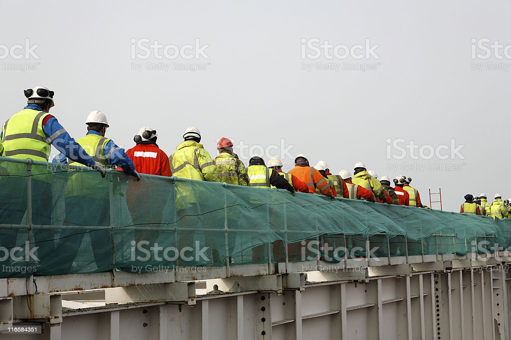 Line of workers royalty-free stock photo