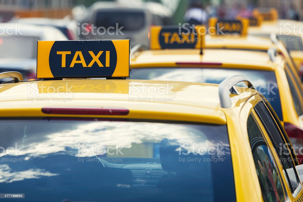 Line of yellow taxis stock photo