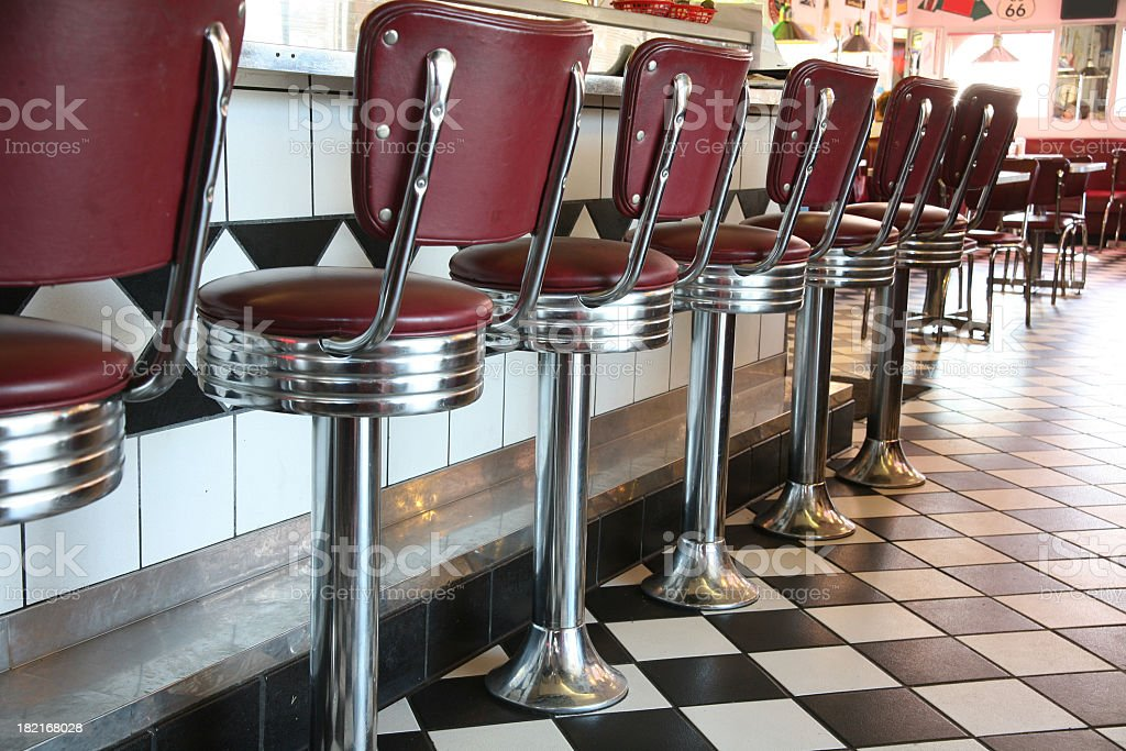 A line up of red diner style chairs  royalty-free stock photo