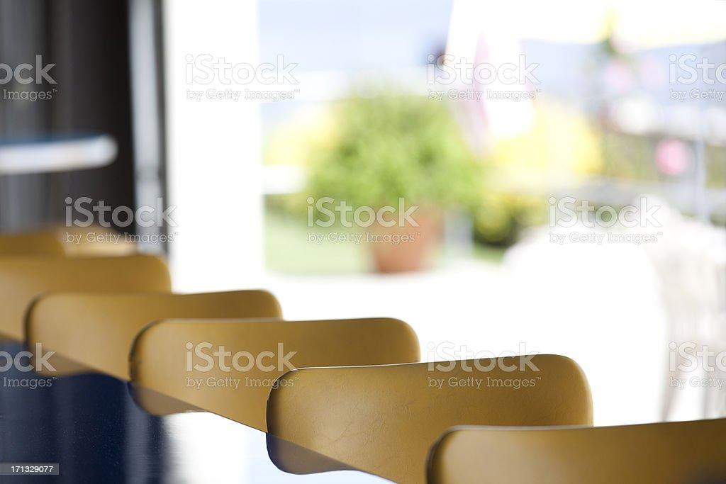 linear bar stool seating royalty-free stock photo