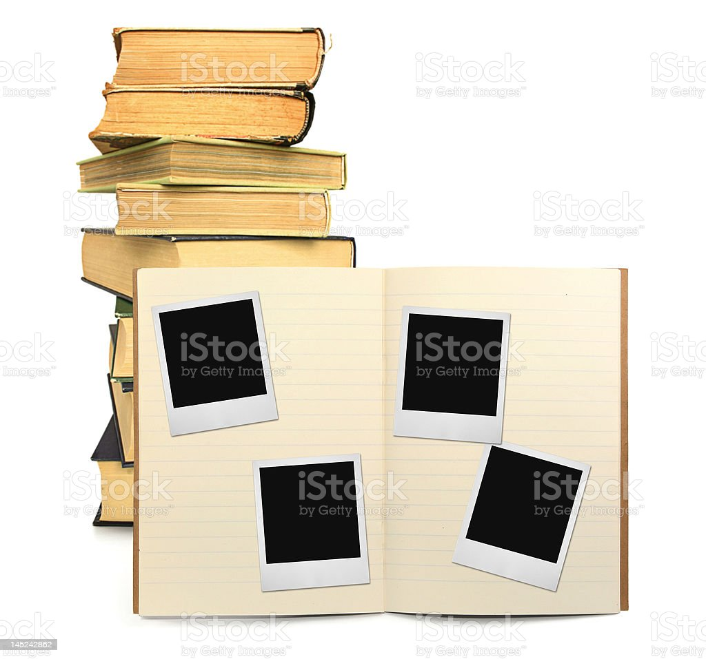 lined exercise book and photo frames royalty-free stock photo