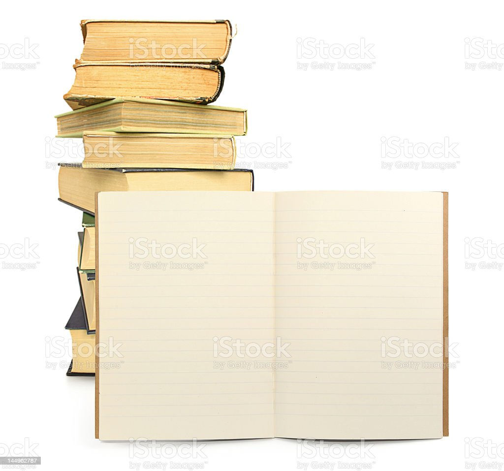 lined exercise book with books in background royalty-free stock photo